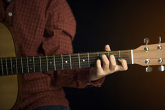 Women playing acoustic guitar Stock Photography