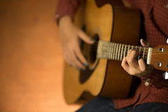 Women playing acoustic guitar Royalty Free Stock Photos