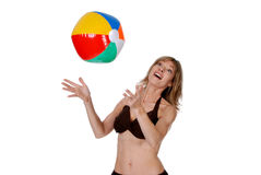 Women playing with a beach ball. Isolated women playing with a beach ball on a white background Royalty Free Stock Photos
