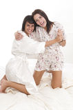 Women playing on the bed Stock Photos