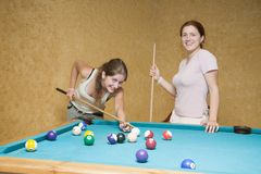Women playing billiards Royalty Free Stock Photos