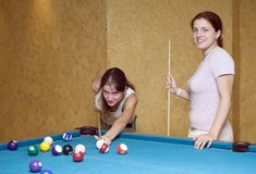 Women playing billiards royalty free stock images