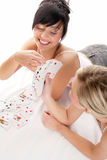 Women with playing cards Stock Photography