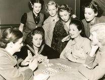 Women playing cards Stock Images