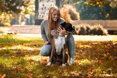 Women Playing With Dog Royalty Free Stock Image
