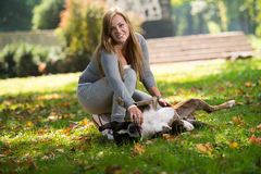 Women Playing With Dog Stock Photography