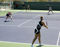 Women playing doubles Stock Photo
