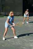 Women playing doubles Stock Images