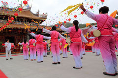 Women playing drum to celebrate the completion of taiqing palace Stock Photography