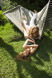 Women playing on hammock. Royalty Free Stock Image