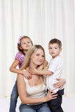 Women playing with her children Royalty Free Stock Photo