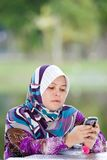 Women playing her mobile phone Royalty Free Stock Images