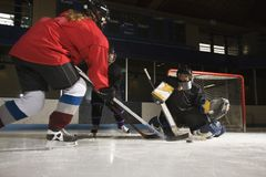 Women playing hockey.