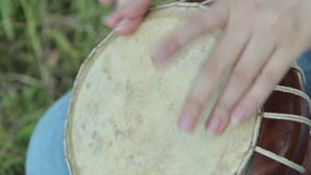 Women playing on Jambe Drum on nature stock video footage