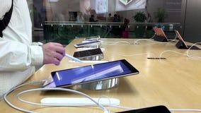 Women playing new ipad pro stock video footage