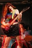 Women playing rock music on stage royalty free stock images