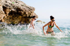 Women playing in the sea Royalty Free Stock Image