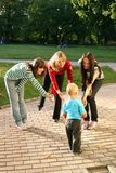 Women playing with small boy stock images