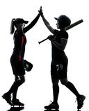 Women playing softball players silhouette isolated Royalty Free Stock Images