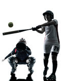 Women playing softball players silhouette isolated. Women playing softball players in silhouette isolated on white background royalty free stock photography