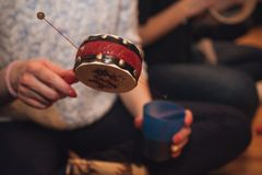 Women playing spin drum no face Royalty Free Stock Images