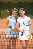 Women playing tennis Stock Images