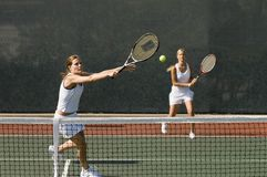 Women Playing Tennis Royalty Free Stock Image