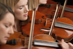 Women Playing Violins Royalty Free Stock Photography