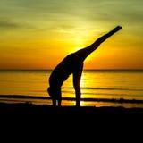 Women playing yoga Stock Photos