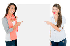 Women pointing a banner Stock Photo
