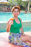 Women at pool side Stock Photography