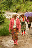 Women porters carrying baskets Royalty Free Stock Photo