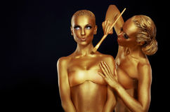 Women portrait in gold colors. stock image