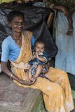 Women portrait, India. Portrait of a senior women holding in her arms a newborn in the remote village of Anchetty, Tamil Nadu, India. Photo taken on 10 June 2018 royalty free stock image