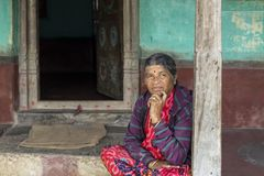 Women portrait, India. Portrait of senior women standing and posing on the porch of her house, in the remote village of Anchetty, Tamil Nadu, India. Photo taken royalty free stock photo