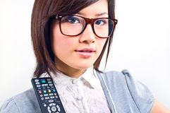 Women portrait with remote control Stock Photos