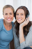 Women posing while listening to music Royalty Free Stock Images
