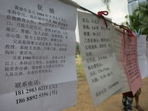 Women Posting Marriage Advertisements in China. Women looking for marriage posted personal ads in the park in Shenzhen, China stock images