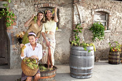 Women pounding grapes in an old farm Royalty Free Stock Image