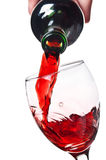 Women pouring red wine into a glass Stock Images