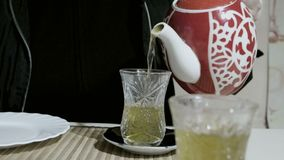 Women pouring turkish tea in ornate glass.  stock video footage