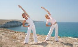 Women practices Yoga royalty free stock image