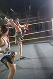 Women practicing body combat attack Royalty Free Stock Photo
