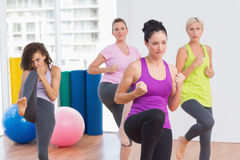 Women practicing kickboxing at fitness studio Royalty Free Stock Photo