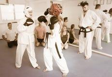 Women practicing at taekwondo class Stock Image