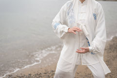 Women practicing Taijiquan on the beach stock photography