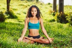 Women practicing yoga Stock Images