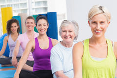 Women practicing yoga during fitness class Royalty Free Stock Images