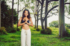 Women practicing yoga in nature, outdoors Royalty Free Stock Photography