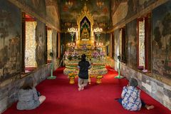 Women praying at buddhist temple Stock Image